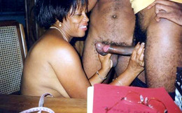 Black milf sucks two dick at once